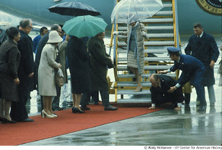 President Ford slips and falls as he leaves Air Force One upon arrival in Vienna, Austria for a state visit.