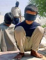 US admits holding juvenile combatants