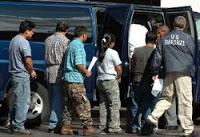 ice: nearly 600 detained in mississippi plant raid