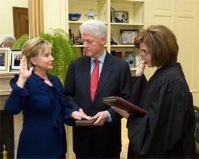 US senate confirms clinton as secretary of state