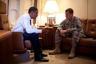 obama meets with killer mcchrystal in denmark