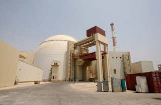iran starts a reactor, while israel has 'hundreds of nuclear bombs'
